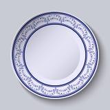 Målade plattor med en blå prydnad i etnisk stil med ett tomt utrymme i mitten Royaltyfria Foton