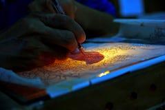 Målare skapar ramen Arkivfoto