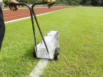Målarfärg för markering för sportfält royaltyfria foton