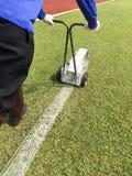 Målarfärg för markering för sportfält royaltyfri foto