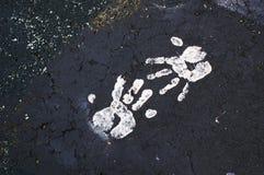 Målarfärg Handprints på trottoar Arkivfoton