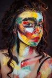 Målarfärg på framsidan av en ung flicka Royaltyfria Foton