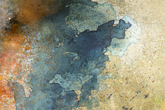 Målarfärg plaskar/fläckar på golvbakgrunden royaltyfri foto