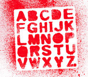 målat alfabet Arkivbild