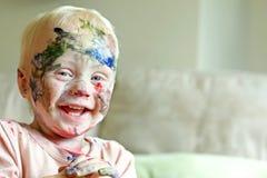 Målat behandla som ett barn att skratta Arkivbild