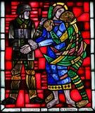 Målat glass avmaskar in - judas som kysser Jesus Arkivbilder