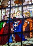 Målat glassfönster av umgänget Arkivfoto