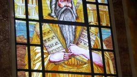 Målat glassfönster med en bild av symbolen Lord God i Christian Church stock video