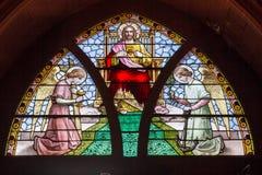 Målat glassfönster som visar Kristus Arkivfoto