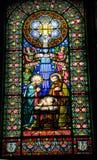 Målat glassNativity behandla som ett barn den Jesus Mary Joseph Monestir kloster Arkivfoton