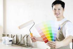 Målat hem- garneringbegrepp arkivbild