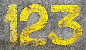 målat jordningsnummer för betong 123 Royaltyfri Fotografi
