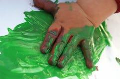 målning för 6 barn Arkivbilder