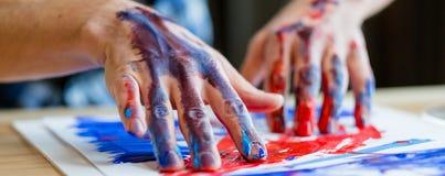 Målning för finger för samtida konsttrend idérik fotografering för bildbyråer