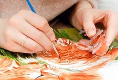 Målning för ung kvinna vid nummer Arkivbilder