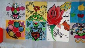 Målningar av barn Arkivbilder