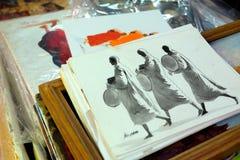 Målningar av munkar säljs som souvenir i Myanmar Arkivbilder