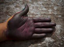 Målningshand med färgteckensymbol fotografering för bildbyråer