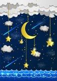 Måne och stjärnor i molnen Arkivfoton
