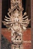 mång- beväpnad gudinna Arkivfoto
