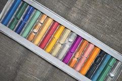 Mång--färgad pastell i asken Arkivbild