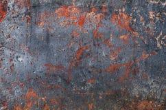Mång--färgad textur på den konkreta yttersidan Rostiga orange fläckar svart metalliskt Royaltyfria Foton