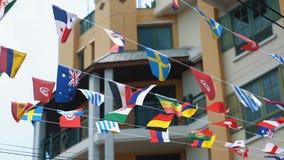 Mång--färgade flaggor av många länder vinkar i luften, ultrarapid Sammanslagning av det olika tillståndsbegreppet stock video