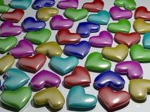 Mång--färgade plast- hjärtor Arkivfoto