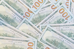 Många amerikanska hundra dollarräkningar royaltyfri bild