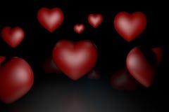 Många av hjärtor på en svart Arkivbilder