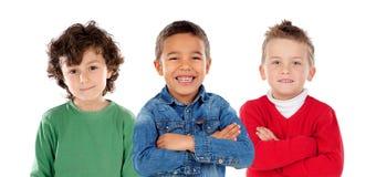 Många barn som ser kameran Fotografering för Bildbyråer