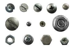 Många belägger med metall huvud av skruvar, muttrar, nitar Arkivfoto