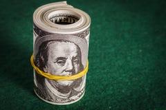 Många Dolars på tabellen Fotografering för Bildbyråer