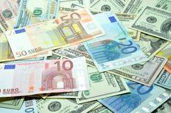 Många dollar och euro royaltyfria bilder