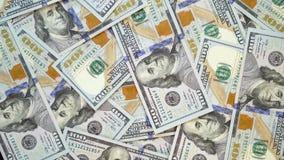 Många dollar roterar Snurrbakgrund av pengar Hape av vända för kassa arkivfilmer