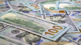 Många dollar roterar Snurrbakgrund av pengar Hape av vända för kassa lager videofilmer