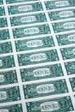 Många en dollar bills jämsides Arkivfoto