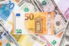 Många euro och dollar, slut upp Royaltyfri Bild