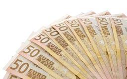 Många 50 eurosedlar som fläktas som isoleras på vit Fotografering för Bildbyråer