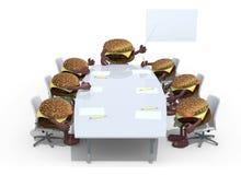 Många följer hamburgaremötet runt om tabellen och deras framstickande Royaltyfria Foton