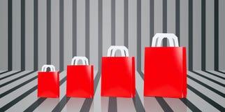 Många förbigår röda shoppingpåsar Arkivbild