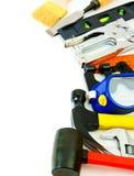 Många funktionsdugliga hjälpmedel - häftapparat, plattång och andra på Royaltyfri Fotografi