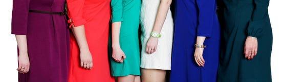 Många händer för kvinna` s, flickor i klänningar royaltyfria bilder