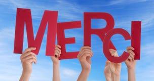Många händer som rymmer en röd merci Fotografering för Bildbyråer