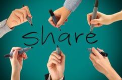 Många händer som skriver aktieord Fotografering för Bildbyråer