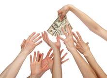 Många händer som ut ner för pengar Royaltyfria Bilder