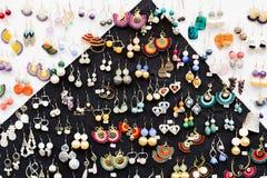 Många handgjorda örhängen Royaltyfria Foton