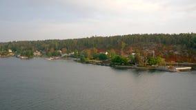 Många hus på Nordsjö bland pinjeskogarna lager videofilmer