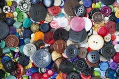 Många knappar av olika former och färger Royaltyfri Fotografi