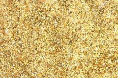 Många lappar den festliga guld- garneringen bakgrund Royaltyfri Fotografi